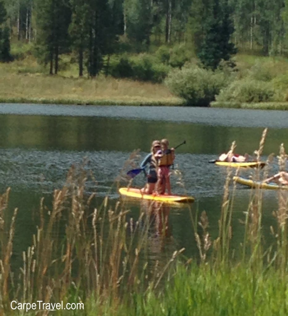 Things to do in Steamboat Springs with Kids - Paddleboarding at Pearl Lake. Click through for more summer and winter activities in Steamboat Springs.