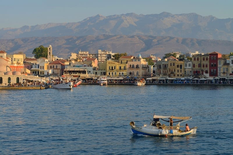Traveling abroad can be prohibitively expensive but if you want to stretch your dollars and make the most of your vacation, check out these surprisingly affordable international spots including Crete in Greece. This photo is of a harbor of Chania, Greece. Chania is one of the most popular tourist place on Crete island in Greece.