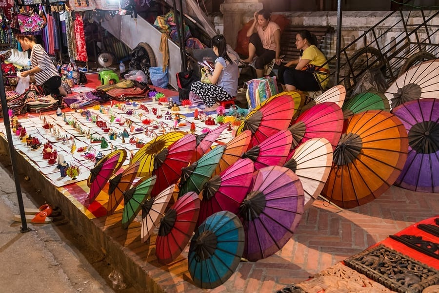 Traveling abroad can be prohibitively expensive but if you want to stretch your dollars and make the most of your vacation, check out these surprisingly affordable international spots including Laos. This photo is of souvenirs beig sold at a night market in Luang Prabang Laos